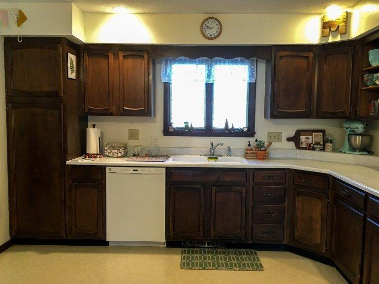 <p>The dark cabinets and low lighting made this kitchen feel out of date and in need of some lightening up.</p>
