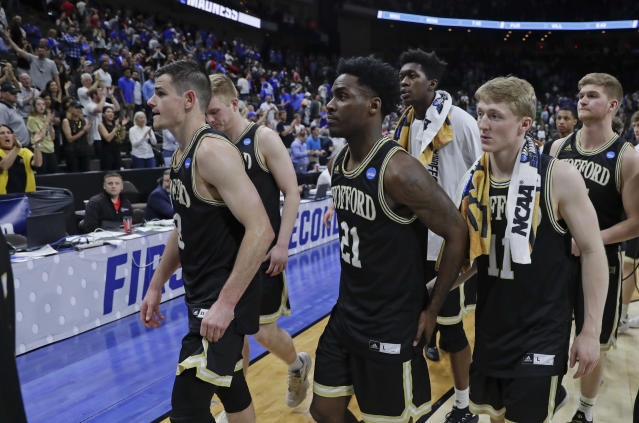Wofford players including Fletcher Magee, left, Tray Hollowell (21), and Ryan Larson, front right, leave the court after losing to Kentucky of a second-round game in the NCAA mens college basketball tournament in Jacksonville, Fla., Saturday, March 23, 2019. (AP Photo/John Raoux)