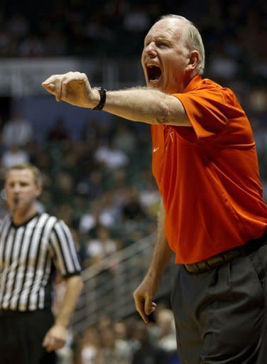 Miami head coach Jim Larranaga calls out to one of his players while taking on Hawaii in the first half of an NCAA college basketball game in the Diamond Head Classic Saturday, Dec. 22, 2012, in Honolulu. (AP Photo/Eugene Tanner)