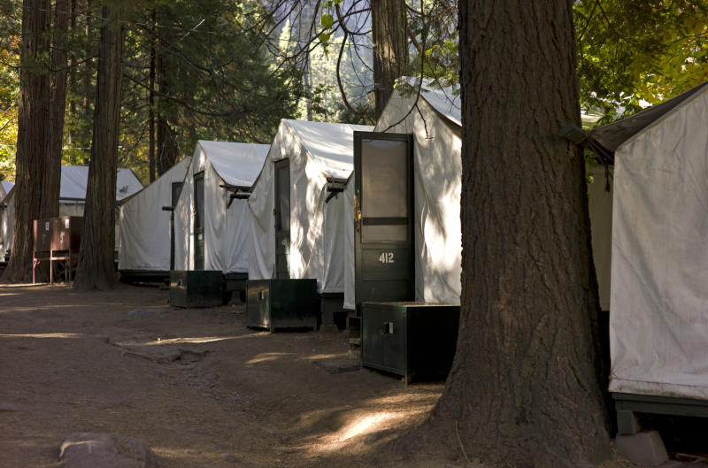 <p>               In this photo from Sunday Oct. 23, 2011, tents are seen in Curry Village in Yosemite National Park, Calif. A man died and a woman became seriously ill after contracting a rare rodent-borne disease that might have been linked to their stay at this popular lodging area in Yosemite National Park, officials said Thursday. The man was the first person to die from hantavirus pulmonary syndrome contracted in the park, though two others were stricken in a more remote area in 2000 and 2010, officials said. Testing by the Centers for Disease Control and the California Department of Public Health showed the virus was present in fecal matter from deer mice trapped in Curry Village, an historic, family friendly area of cabins. (AP Photo/Ben Margot)