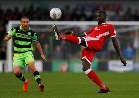 Soccer Football - Carabao Cup First Round - Forest Green Rovers vs Milton Keynes Dons - Nailsworth, Britain - August 8, 2017  MK Dons' Ousseynou Cisse in action with Forest Green Rovers' Liam Noble   Action Images/Paul Childs