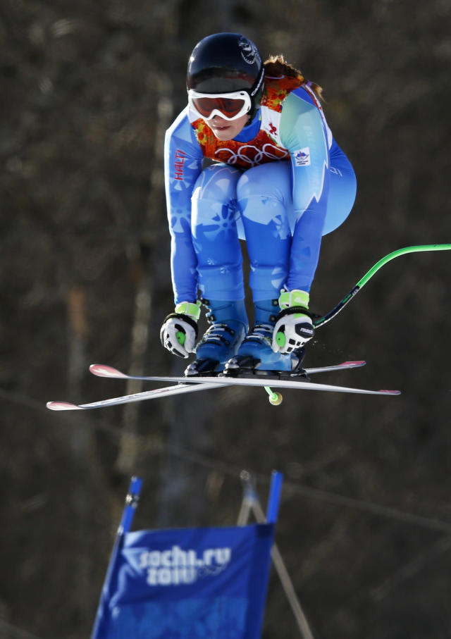 Slovenia's Tina Maze takes a jump during the women's alpine skiing downhill race at the 2014 Sochi Winter Olympics at the Rosa Khutor Alpine Center February 12, 2014. REUTERS/Stefano Rellandini (RUSSIA - Tags: OLYMPICS SPORT SKIING)