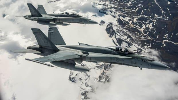 Two Royal Canadian Air Force CF-18s in flight.