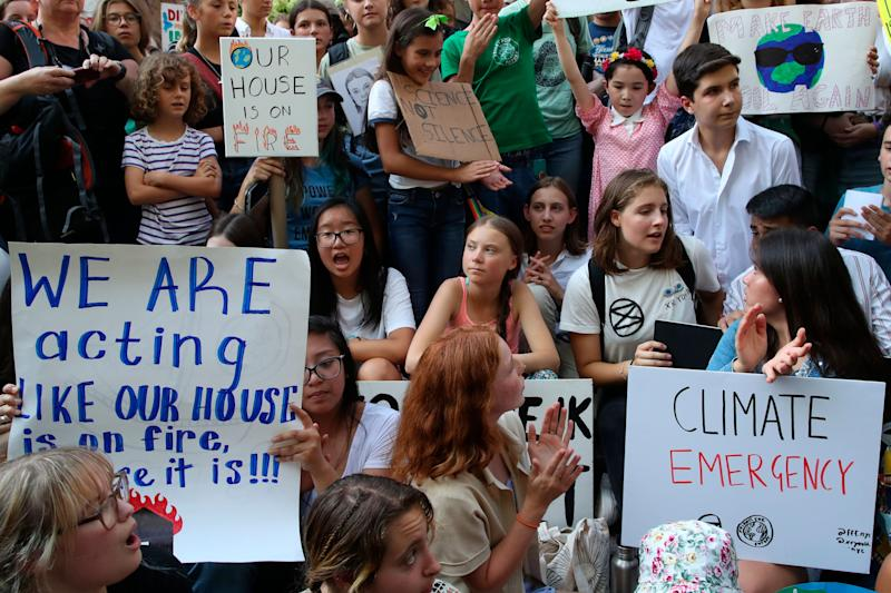 Swedish environmental activist Greta Thunberg, center, participates in a youth climate strike outside the United Nations, on Aug. 30, 2019 in New York.  (Photo: ASSOCIATED PRESS)