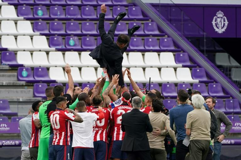 Air travel: Atletico Madrid players toss coach Diego Simeone into the air