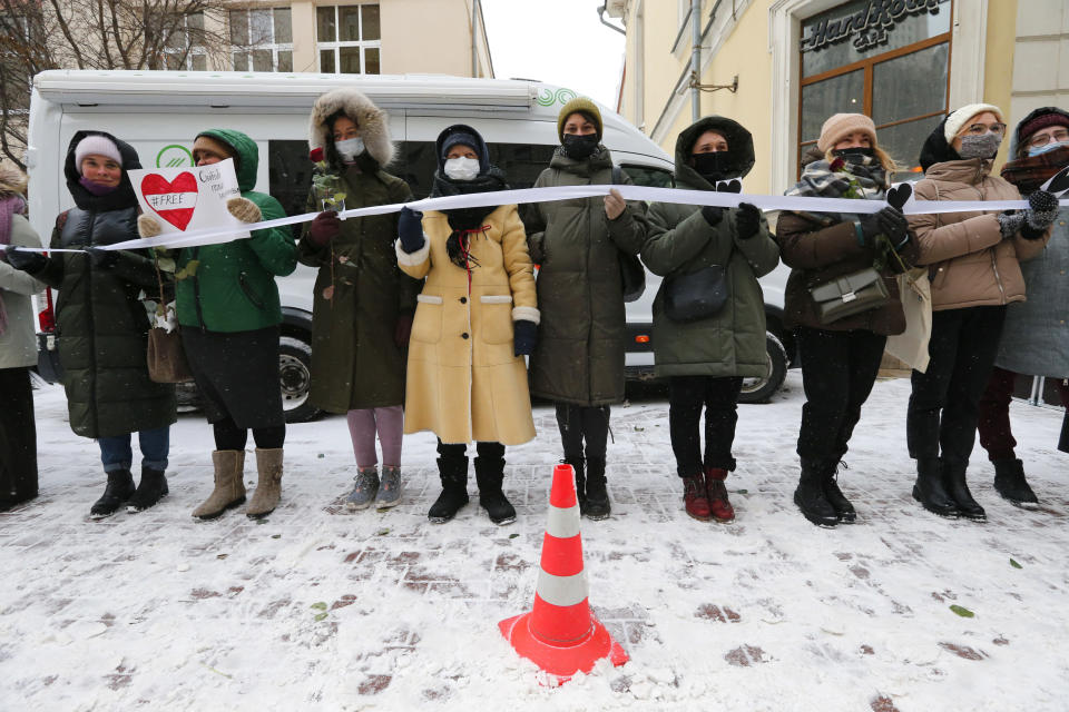 Women, some of them wearing face masks to protect against coronavirus, attend a rally in support of jailed opposition leader Alexei Navalny, and his wife Yulia Navalnaya at Arbat street in Moscow, Russia, Sunday, Feb. 14, 2021. The weekend protests in scores of cities last month over Navalny's detention represented the largest outpouring of popular discontent in years and appeared to have rattled the Kremlin. (AP Photo/Alexander Zemlianichenko)