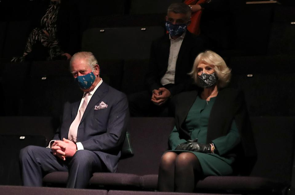 LONDON, ENGLAND - DECEMBER 03: Prince Charles, Prince of Wales, Camilla, Duchess of Cornwall and Mayor of London Sadiq Khan (behind centre) wear face masks as they watch a short rehearsal performance during their visit to Soho Theatre to celebrate London's night economy on December 03, 2020 in London, England. (Photo by Chris Jackson - WPA Pool/Getty Images)