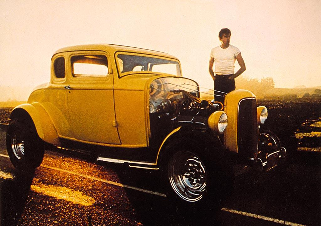 """1932 FORD MODEL B  a/k/a Deuce Coupe  As Seen In: <a href=""""http://movies.yahoo.com/movie/1800340805/info"""">American Graffiti</a>  Key Technical Specs: Modified 1966 Chevrolet 327 cubic in. engine; 5-window configuration; no hood.   For most teens in the early '60s, cruising the main drag listening to Wolfman Jack was all it took for a good time. But nothing matched the excitement of a real drag race, especially the night Bob Falfa flipped his '55 Chevy when he took on John Milner in this unforgettable hot rod.   Available Options: Canary Yellow paint job lets everyone know who's the fastest on the strip."""