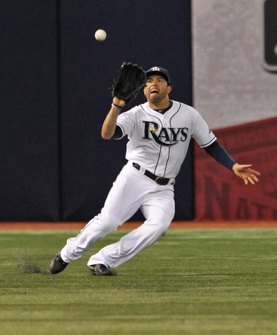 Tampa Bay Rays left fielder David DeJesus misplays a fly ball hit by Washington Nationals' Denard Span during the fifth inning of a baseball game Tuesday, June 16, 2015, in St. Petersburg, Fla. A run scored on the error. (AP Photo/Steve Nesius)