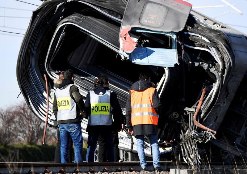 FILE PHOTO: Emergency personnel at the site of the train derailment near Lodi, Italy.