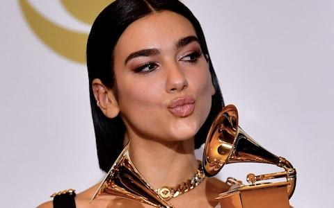 "British singer Dua Lipa poses with her awards for Best New Artist and Best Dance Recording ""Electricity"" after the 61st Annual Grammy Awards - Credit: AFP"