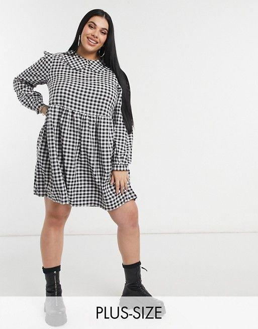 """<p><strong>Daisy Street</strong></p><p>us.asos.com</p><p><strong>$45.00</strong></p><p><a href=""""https://go.redirectingat.com?id=74968X1596630&url=https%3A%2F%2Fwww.asos.com%2Fus%2Fdaisy-street-plus%2Fdaisy-street-plus-mini-smock-dress-with-collar-in-gingham-check%2Fprd%2F22854256&sref=https%3A%2F%2Fwww.cosmopolitan.com%2Fstyle-beauty%2Ffashion%2Fg30460311%2Fspring-work-outfit-ideas%2F"""" rel=""""nofollow noopener"""" target=""""_blank"""" data-ylk=""""slk:Shop Now"""" class=""""link rapid-noclick-resp"""">Shop Now</a></p><p>A sweet collared dress in a gingham print is on-trend for spring, and you can add a pop of color with your footwear or opt for edgy combat boots. </p>"""