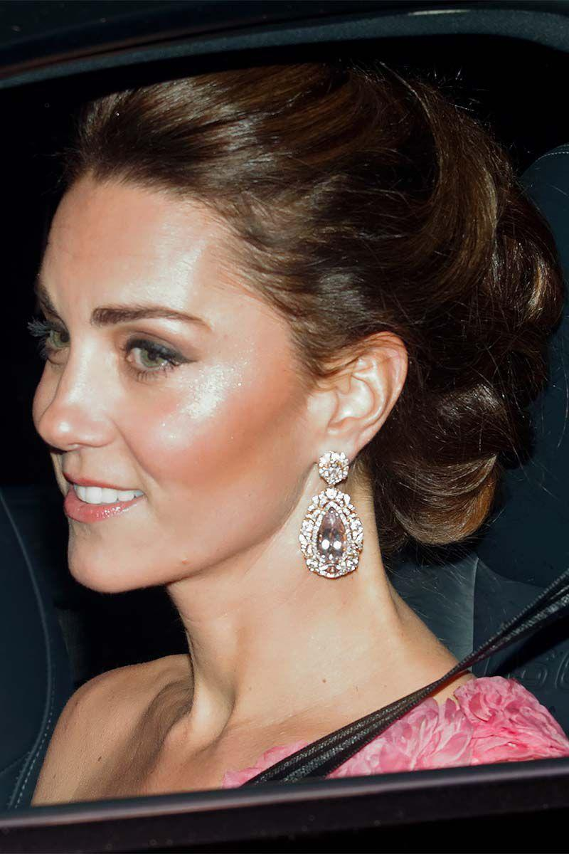 """<p>For Prince Charles' <a href=""""https://www.harpersbazaar.com/celebrity/latest/a25100717/kate-middleton-prince-charles-birthday-party-buckingham-palace/"""" rel=""""nofollow noopener"""" target=""""_blank"""" data-ylk=""""slk:70th birthday party"""" class=""""link rapid-noclick-resp"""">70th birthday party</a>, the Duchess of Cambridge was all about the glamour sporting an intricate updo and diamond drop earrings. </p>"""