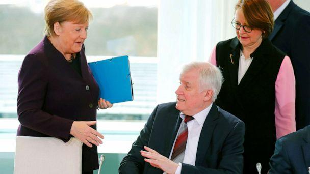 PHOTO: German Interior Minister Horst Seehofer refuses to shake the hand of German Chancellor Angela Merkel for hygienic reasons before a migration summit at the Chancellery in Berlin, Germany, March 2, 2020. (Hannibal Hanschke/Reuters)