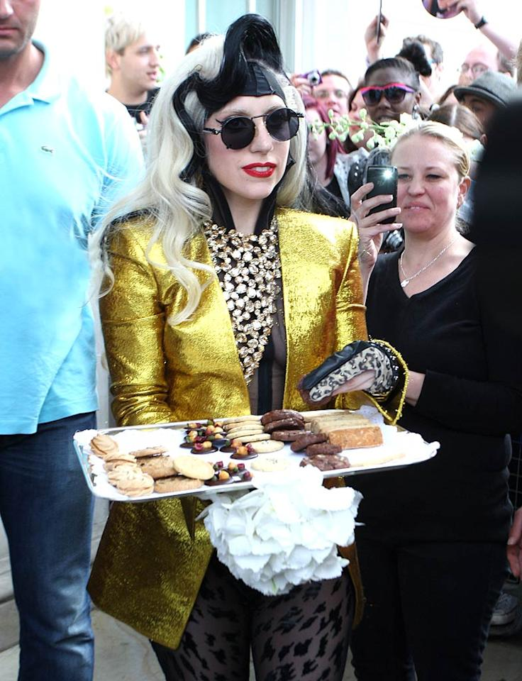 "The only thing that makes fans happier than a live appearance by their favorite celebrity is a live appearance by their favorite celebrity bearing food! <a href=""http://omg.yahoo.com/blogs/jam/lady-gaga-tops-celebrity-100-list/32' target="">Forbes' most powerful celebrity</a> left her London hotel on Saturday to greet her ""Little Monsters"" with biscuits and flowers. Thanks, Gaga! WeirPhotos/<a href=""http://www.splashnewsonline.com"" target=""new"">Splash News</a> - May 14, 2011"