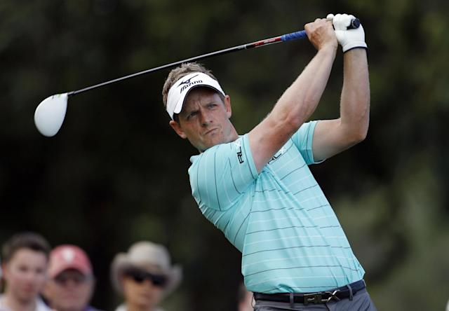Luke Donald, of England, hits from the 17th tee during the second round of the Cadillac Championship golf tournament Friday, March 9, 2012, in Doral, Fla. (AP Photo/Lynne Sladky)