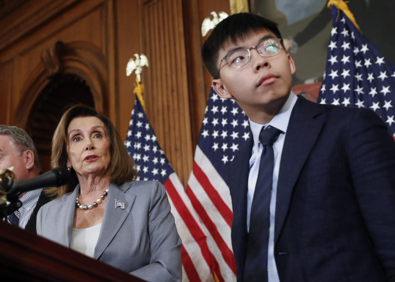 House Speaker Nancy Pelosi, left, with Hong Kong activist Joshua Wong and other members of Congress during a news conference on human right in Hong Kong on Capitol Hill in Washington, Wednesday, Sept. 18, 2019. (AP Photo/Pablo Martinez Monsivais)