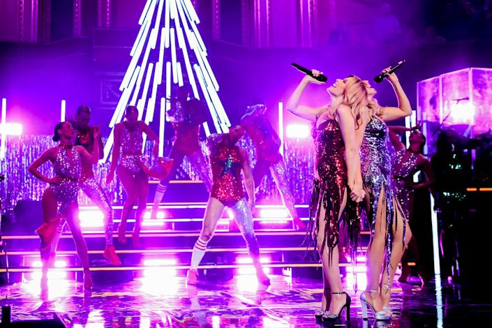 LONDON, ENGLAND - DECEMBER 11:  Kylie Minogue is joined by Dannii Minogue on stage during her Christmas show at the Royal Albert Hall on December 11, 2015 in London, England.  (Photo by Christie Goodwin/Getty Images)