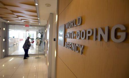 FILE PHOTO - A woman walks into the head office for the World Anti-Doping Agency (WADA) in Montreal, Quebec, Canada on November 9, 2015. REUTERS/Christinne Muschi/File Photo Picture Supplied by Action Images