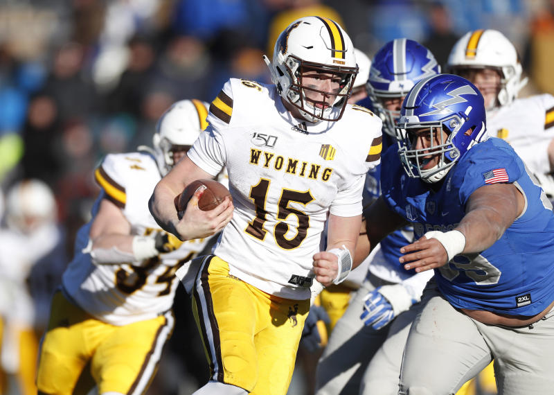 Wyoming quarterback Levi Williams, left, is tackled by Air Force defensive lineman Mosese Fifita after a short gain in the second half of an NCAA college football game Saturday, Nov. 30, 2019, at Air Force Academy, Colo. Air Force won 20-6. (AP Photo/David Zalubowski)