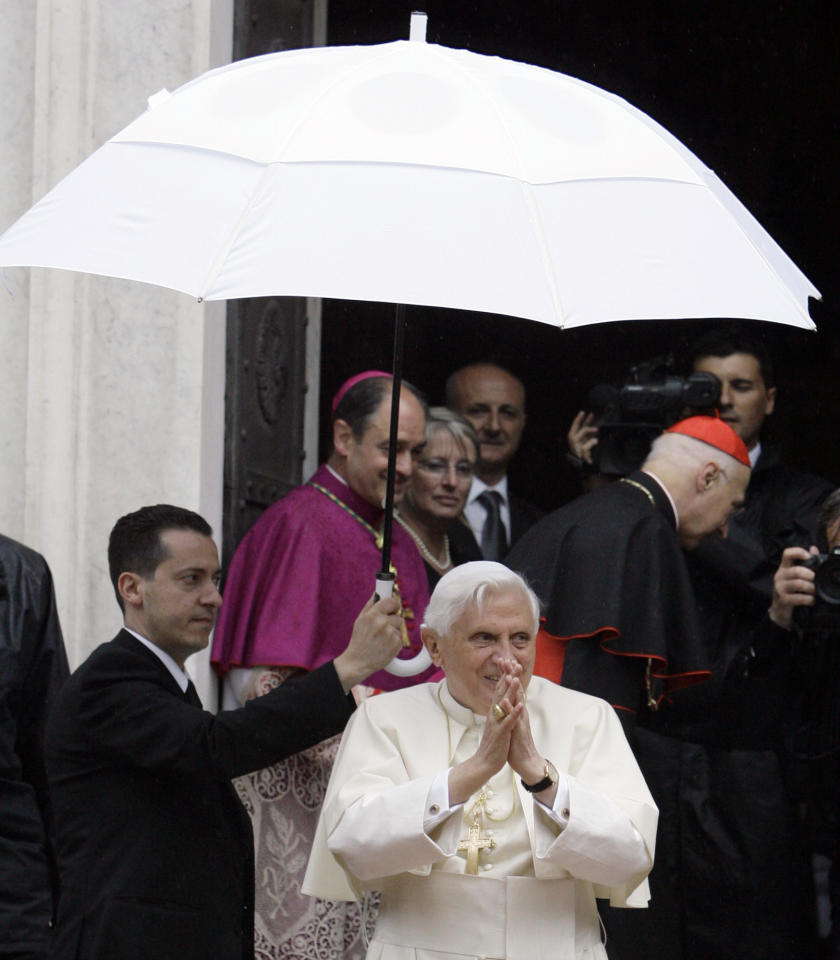 FILE - In this May 17, 2008 file photo, Pope Benedict XVI acknowledges faithful upon his arrival at the Our Lady of Mercy Shrine in Savona, near Genoa, Italy, Saturday, May 17, 2008. The Vatican has confirmed Saturday, May 26, 2012, that the pope's butler Paolo Gabriele, at left holding the umbrella, was arrested in an embarrassing leaks scandal. Spokesman the Rev. Federico Lombardi said Paolo Gabriele was arrested in his home inside Vatican City with secret documents in his possession. (AP Photo/Luca Bruno, file)