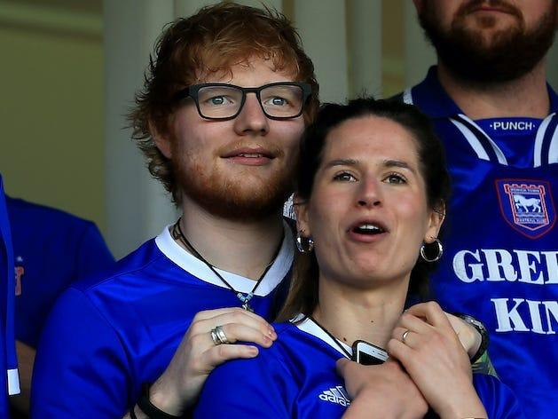 Musician Ed Sheeran and fiance Cherry Seaborn look on during the Sky Bet Championship match between Ipswich Town and Aston Villa at Portman Road on April 21, 2018 in Ipswich, England. (Photo by Stephen Pond/Getty Images)