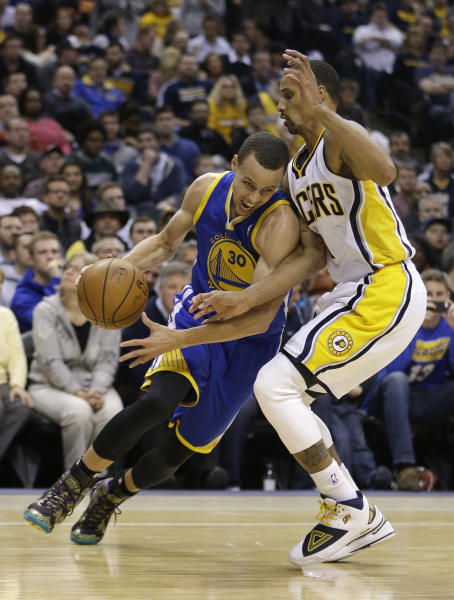 Golden State Warriors' Stephen Curry (30) goes to the basket against Indiana Pacers' George Hill (3) during the first half of an NBA basketball game Tuesday, March 4, 2014, in Indianapolis. (AP Photo/Darron Cummings)