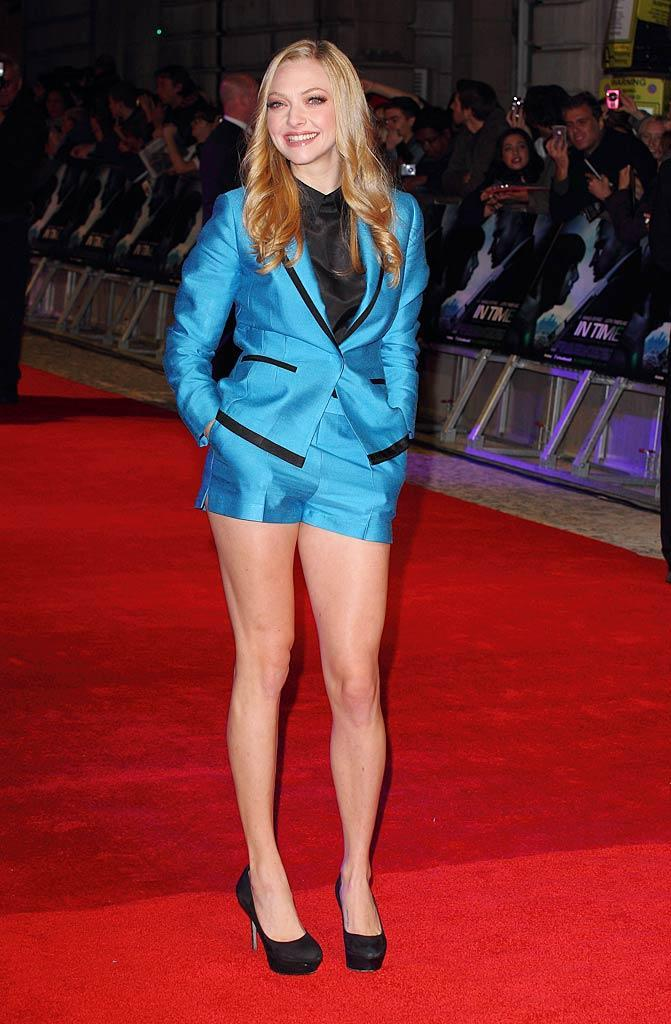"Amanda Seyfriend took a risk on the red carpet at the London ""In Time"" premiere wearing a turquoise short suit from H&M. While the getup accentuated her great gams, we can't imagine it was very comfortable to sit through a movie in! What do you think -- did Amanda's look sizzle ... or fizzle? (10/31/2011)"