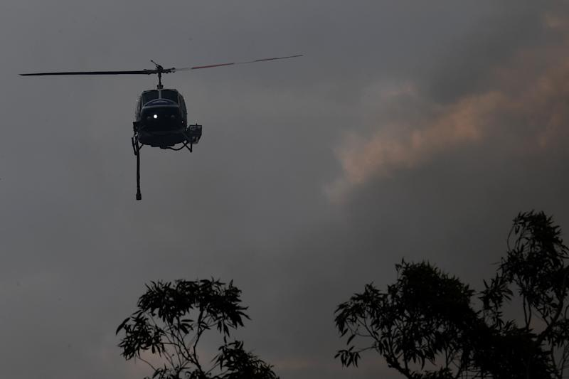 A water bombing helicopter over the Gospers Mountain fire on Tuesday.