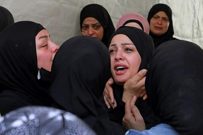 Relatives mourn during the funeral of Palestinian Ahmad Jameel Fahad, who was killed by Israeli forces in a predawn raid, in the Al-Amari refugee camp near Ramallah in the Israeli-occupied West Bank on May 25
