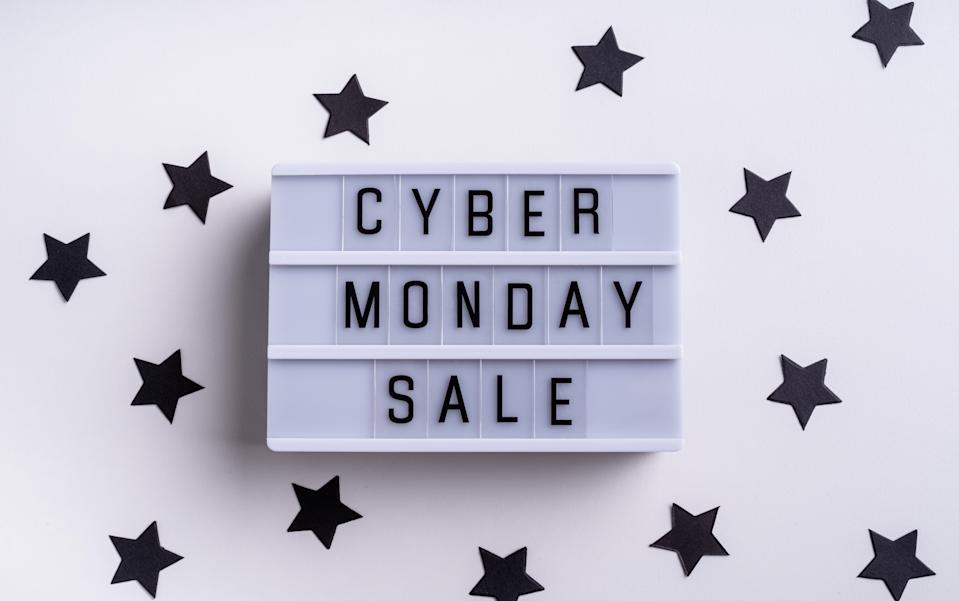 Cyber Mnday shopping concept. Cyber Monday Sale words on lightbox with confetti top view flat lay on white background