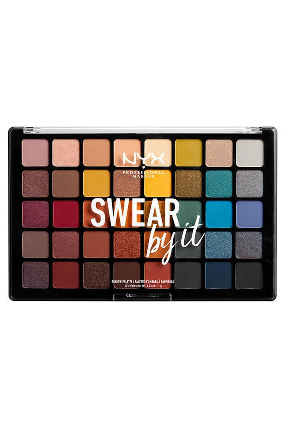 """<p><strong>NYX Professional Makeup</strong></p><p>nyxcosmetics.com</p><p><strong>$35.00</strong></p><p><a href=""""https://go.redirectingat.com?id=74968X1596630&url=https%3A%2F%2Fwww.nyxcosmetics.com%2Feyes%2Feyeshadow-palettes%2Fswear-by-it-shadow-palette%2FNYX_635.html&sref=https%3A%2F%2Fwww.seventeen.com%2Fbeauty%2Fg29487979%2Fbest-eyeshadow-makeup-palettes%2F"""" rel=""""nofollow noopener"""" target=""""_blank"""" data-ylk=""""slk:SHOP NOW"""" class=""""link rapid-noclick-resp"""">SHOP NOW</a></p><p>Featuring a fab assortment of cool and warm tones, as well as metallics and mattes, this fun palette is a product you'll <em>swear by</em>. And at $35, 40 shades is such a bargain!</p>"""