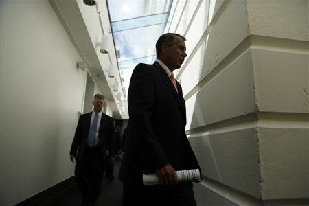 Boehner arrives for a meeting with fellow House Republicans at the U.S. Capitol in Washington