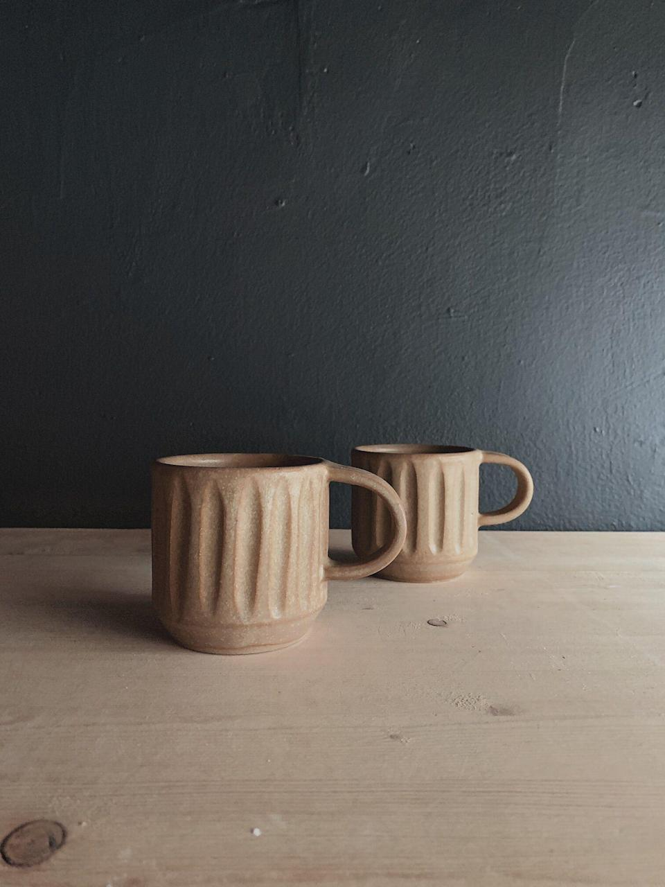 """<p>samleehello.com</p><p><strong>$40.00</strong></p><p><a href=""""https://www.samleehello.com/shop/milo-carved-mug-aged-ochre"""" rel=""""nofollow noopener"""" target=""""_blank"""" data-ylk=""""slk:SHOP NOW"""" class=""""link rapid-noclick-resp"""">SHOP NOW</a></p><p>Pro potter and illustrator Sam Lee sells mugs, vases, light pendants, and art prints. The ceramics expert also owns the San Francisco-based <a href=""""https://www.dustedandblue.com/"""" rel=""""nofollow noopener"""" target=""""_blank"""" data-ylk=""""slk:Dusted and Blue Pottery Studio and Shop"""" class=""""link rapid-noclick-resp"""">Dusted and Blue Pottery Studio and Shop</a>, where you can buy pottery-making tools and take classes.</p>"""