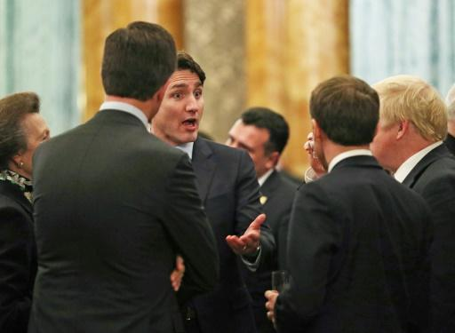 Canadian Prime Minister Justin Trudeau, (3rdL) speaks with and Britain's Prime Minister Boris Johnson (R), France's President Emmanuel Macron (2ndR), NATO Secretary General Jens Stoltenberg (2ndL) and Britain's Princess Anne at Buckingham Palace