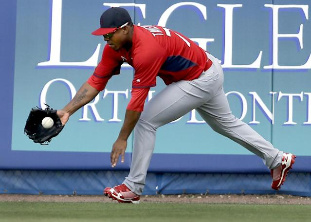 St. Louis Cardinals right fielder Oscar Taveras reaches for a ball hit off the outfield wall for a double by New York Mets' Travis d'Arnaud during the fifth inning of an exhibition spring training baseball game Friday, March 7, 2014, in Port St. Lucie, Fla. (AP Photo/Jeff Roberson)