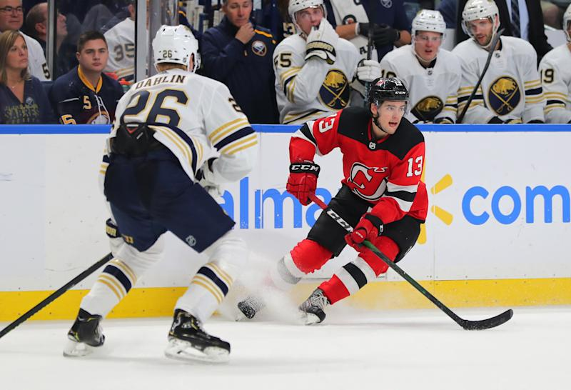 Oct 5, 2019; Buffalo, NY, USA; Buffalo Sabres defenseman Rasmus Dahlin (26) watches as New Jersey Devils center Nico Hischier (13) looks to make a pass during the third period at KeyBank Center. Mandatory Credit: Timothy T. Ludwig-USA TODAY Sports
