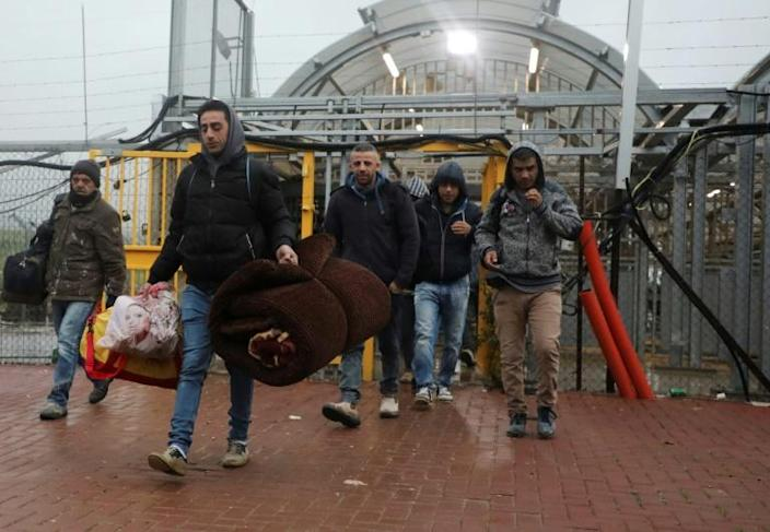 Thousands of Palestinian labourers crossed into Israel on Wednesday carrying their belongings for what could be a long-term stay amid the coronavirus pandemic (AFP Photo/HAZEM BADER)