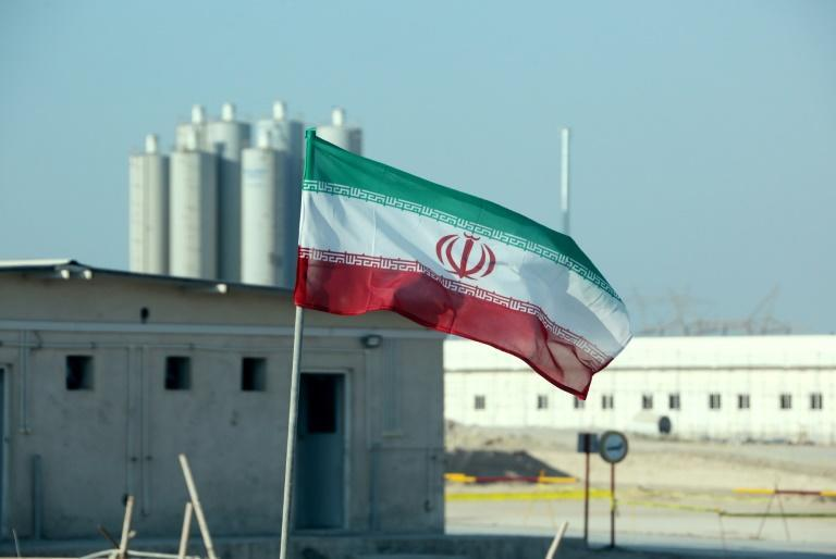 An Iranian flag at the Bushehr nuclear power plant, during an official 2019 ceremony to kick-start works on a second reactor at the facility