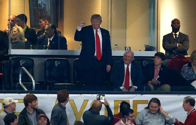 U.S. President Donald Trump waves to fans during the first half of the 2018 College Football Playoff title game between Georgia and Alabama. (Mike Zarrilli/Getty Images)