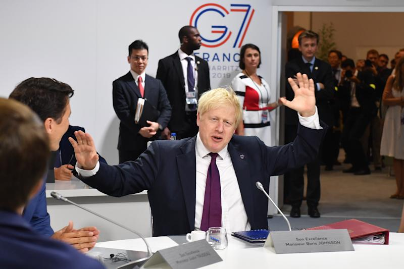 BIARRITZ, FRANCE - AUGUST 25: Britain's Prime Minister Boris Johnson attends the first working session of the G7 Summit on August 25, 2019 in Biarritz, France. The French southwestern seaside resort of Biarritz is hosting the 45th G7 summit from August 24 to 26. High on the agenda will be the climate emergency, the US-China trade war, Britain's departure from the EU, and emergency talks on the Amazon wildfire crisis. (Photo by Jeff J Mitchell - Pool /Getty Images)