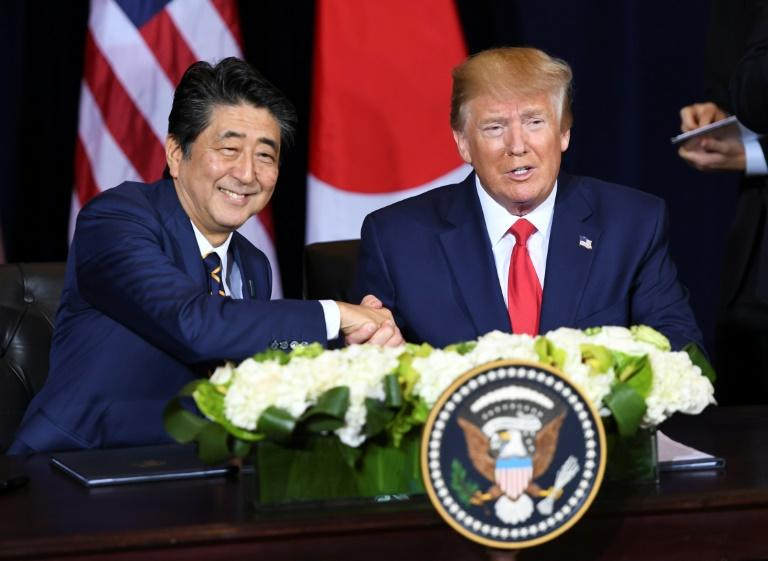US President Donald Trump and Japanese Prime Minister Shinzo Abe shake hands after signing a trade agreement in New York, September 25, 2019, on the sidelines of the United Nations General Assembly