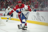 Detroit Red Wings center Sam Gagner (89) and Tampa Bay Lightning center Ross Colton (79) battle for position in the first period of an NHL hockey game Thursday, Oct. 14, 2021, in Detroit. (AP Photo/Paul Sancya)