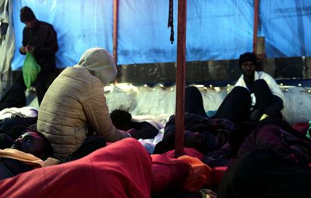 Migrants takes rest on the MV Aquarius, a search and rescue ship run in partnership between SOS Mediterranee and Medecins Sans Frontieres on their way to Spain, June 13, 2018. Karpov / SOS Mediterranee/handout via REUTERS
