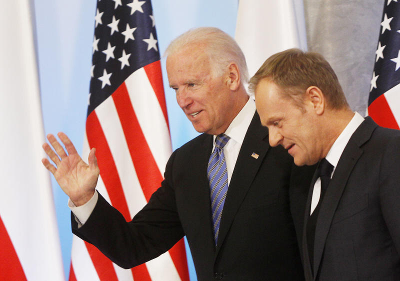 U.S. Vice President Joe Biden, left, and Poland's Prime Minister Donald Tusk, right, are heading for talks on Eastern Europe's security, in Warsaw, Poland, on Tuesday, March 18, 2014. Biden is in Poland on a trip designed to show U.S. resolve against Russia's intervention in Ukraine. Poland borders both Russia and Ukraine. Later Tuesday Biden will also meet with Poland's President Bronislaw Komorowski and with Estonian President Toomas Hendrik Ilves. The meetings with the NATO allies are part of a broader U.S. campaign to persuade Russian President Vladimir Putin to back off in Ukraine. (AP Photo/Czarek Sokolowski)