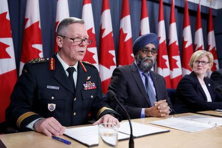 Canada's Chief of the Defence Staff General Jonathan Vance (L) speaks during a news conference with Defence Minister Harjit Sajjan (C) and Public Works Minister Carla Qualtrough in Ottawa, Ontario, Canada, December 12, 2017. REUTERS/Chris Wattie