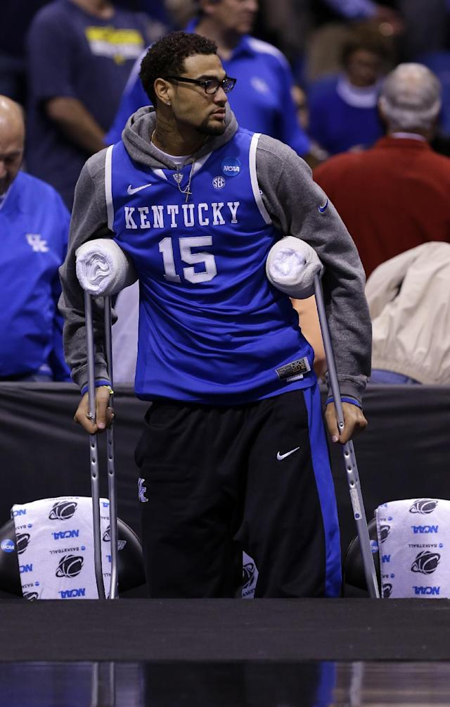 Kentucky's Willie Cauley-Stein is seen on the bench with crutches before an NCAA Midwest Regional final college basketball tournament game against Michigan Sunday, March 30, 2014, in Indianapolis. (AP Photo/Michael Conroy)