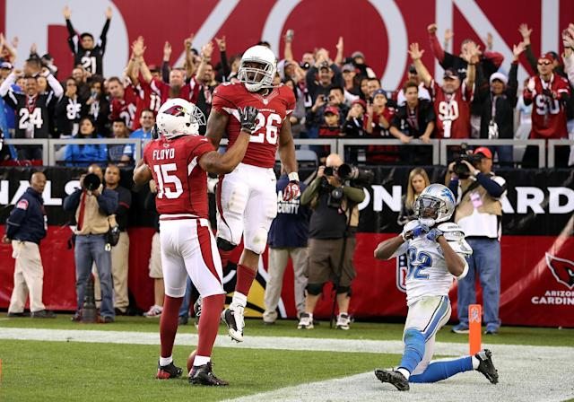 GLENDALE, AZ - DECEMBER 16: Running back Beanie Wells #26 of the Arizona Cardinals celebrates with wide receiver Michael Floyd #15 after Wells scored a 31 yard rushing touchdown against the Detroit Lions during the fourth quarter of the NFL game at the University of Phoenix Stadium on December 16, 2012 in Glendale, Arizona. The Cardinals defeated the Lions 38-10. (Photo by Christian Petersen/Getty Images)
