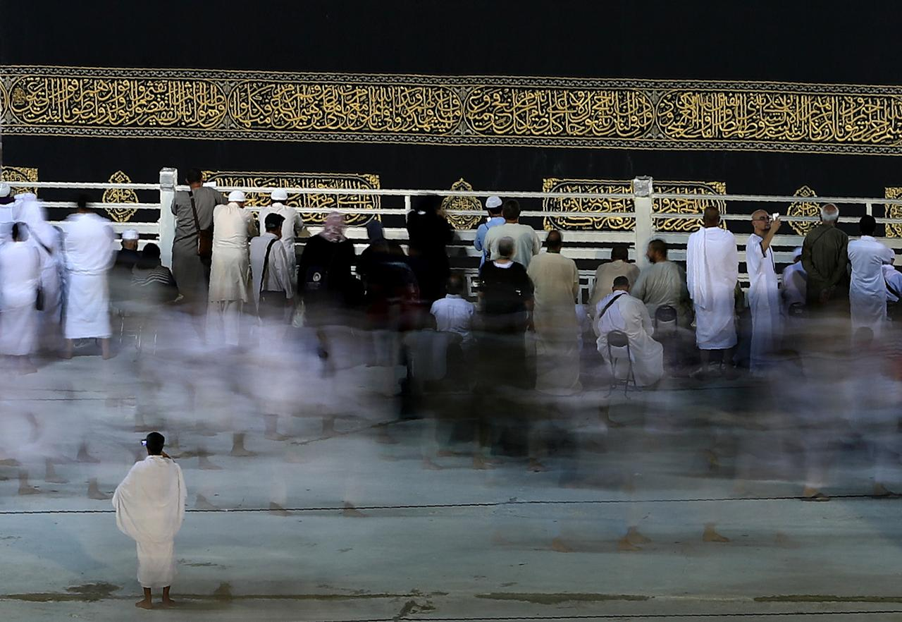<p>This long exposure photograph shows Muslim pilgrims circumambulating the Kaaba, Islam's holiest shrine, at the Grand Mosque in Saudi Arabia's holy city of Mecca, on Aug. 29, 2017, on the eve of the start of the annual hajj pilgrimage. (Photo: Karim Sahib/AFP/Getty Images) </p>