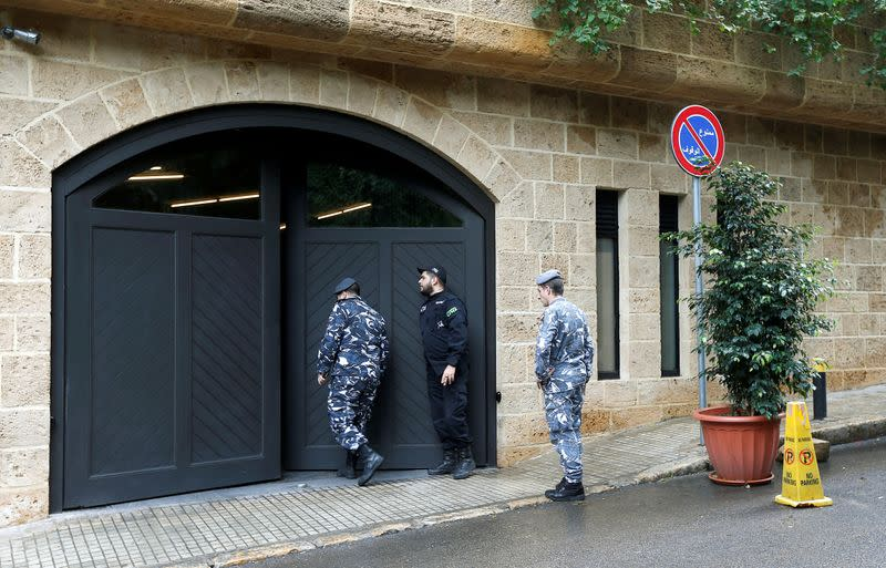 Lebanese police officers are seen at the entrance to the garage of what is believed to be Carlos Ghosn's house in Beirut